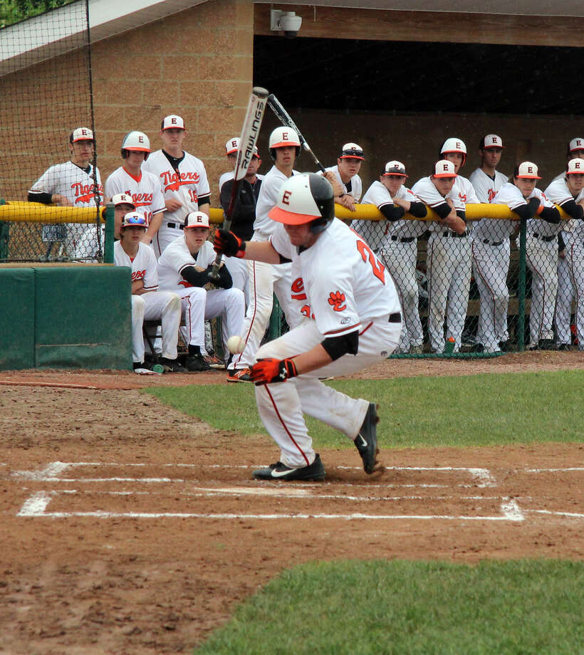 Edwardsville junior Joe Wallace is hit by a pitch during the second inning of Saturday's game at Tom Pile Field.