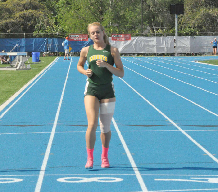 Metro-East Lutheran High School senior Jessica Jump jogs her way to a finish in the 200-meter dash at the Class 1A state finals in Charleston on Saturday. Jump re-aggrevated a left hamstring injury in her first race, but jogged through the final two to end her career as a Knight.