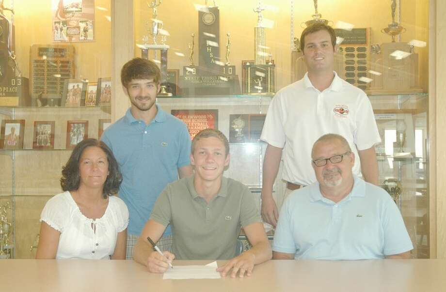 Edwardsville High School graduate Tony Miner recently signed with Lindenwood University in Belleville to play men's volleyball in the upcoming spring. Pictured seated from left to right are: Shari Miner, mother, Tony Miner and Craig Miner, father. Standing from left to right are Joey Miner, brother, and EHS  boys' volleyball head coach Andy Bersett.