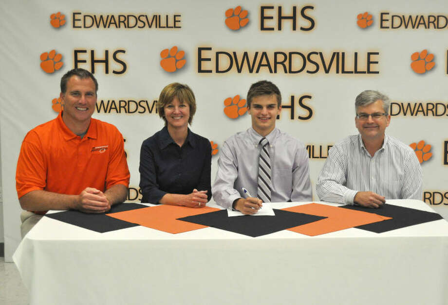 Edwardsville's Brian Crowe recently signed on to play football at Washington University. Seated from left to right are: EHS head football coach Matt Martin, Julia Crowe, mother, Brian Crowe and Michael Crowe, father.