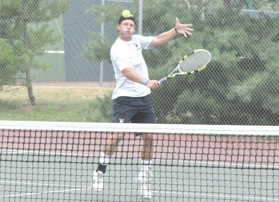 Kyle Dawson of Yale University hits a backhand during singles action in the wildcard tournament of the Edwardsville Futures Monday at the EHS Tennis Center.