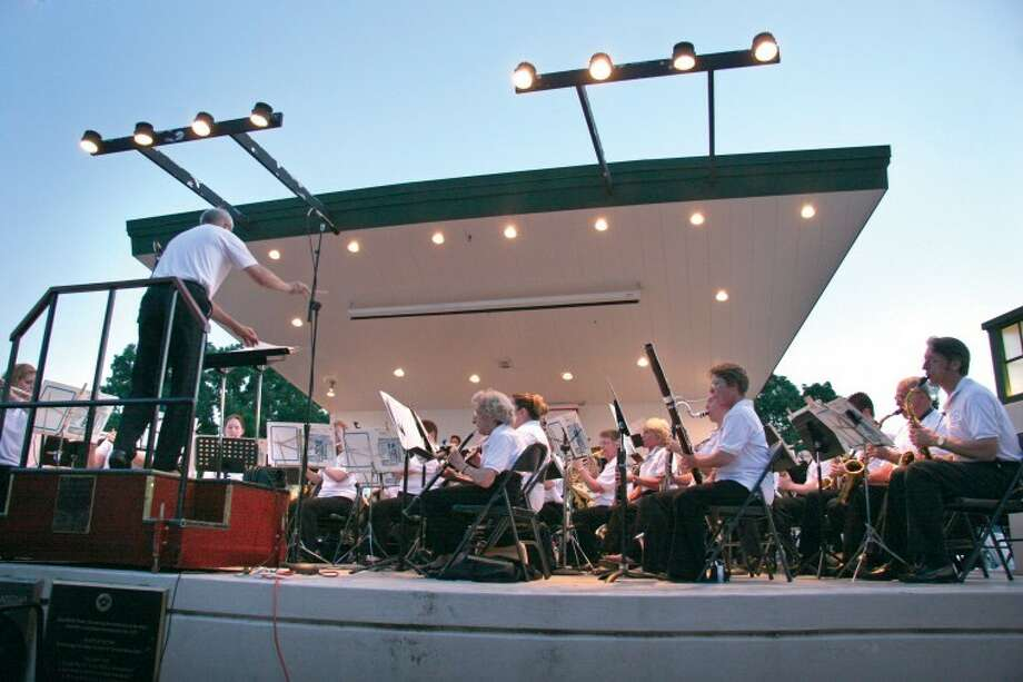 James Kerfoot, on podium, leads the Edwardsville Municipal Band during a recent concert in City Park. Photo: Marci Winters-McLaughlin/Intelligencer