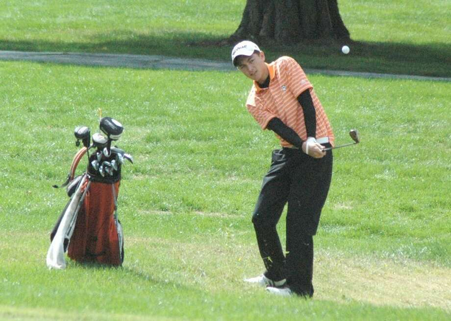 Edwardsville Tiger Nic Bryant hits an iron shot at Belk Park Golf Course on Tuesday during the Southwestern Conference Tournament.