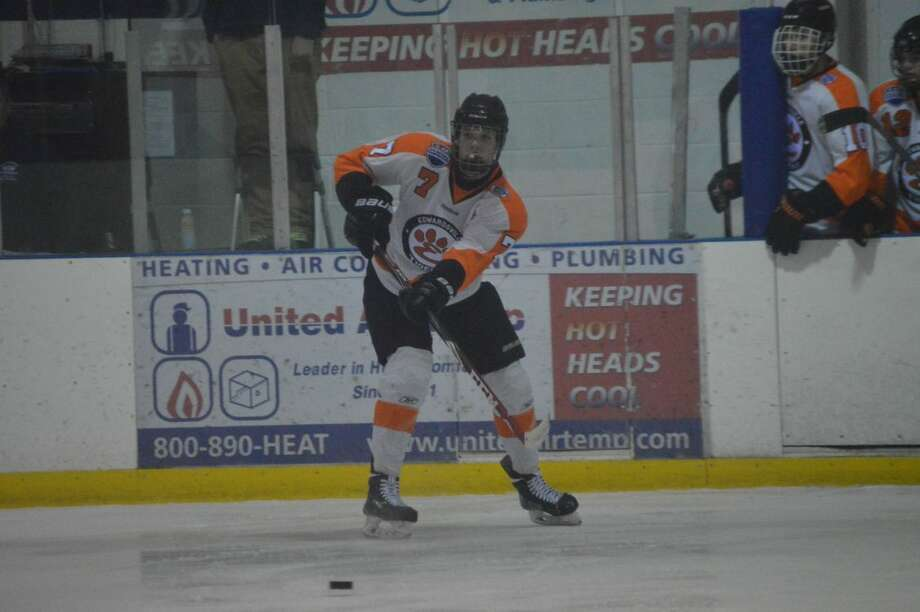 Edwardsville's Colin Kelsey delivers a pass in the neutral zone during the first period.