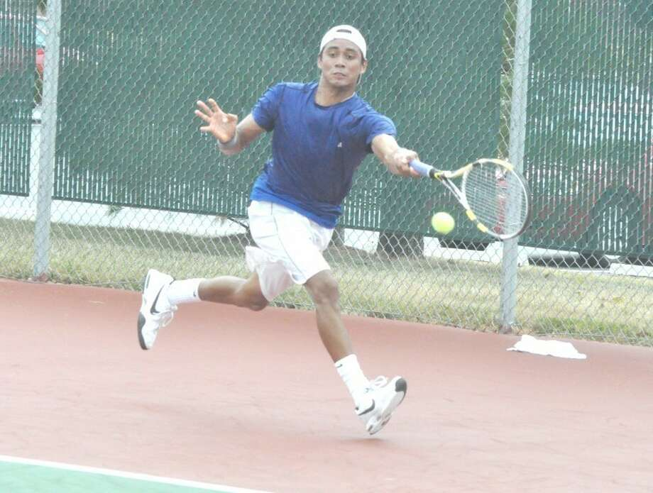Junior Ore, a Texas A&M tennis player, lunges for a return shot at the EHS Tennis Center on Friday in the first day of the qualifying tournament for the Edwardsville Futures. Ore defeated Australian Elliot Keyser 6-3, 6-3 to advance to the next round.