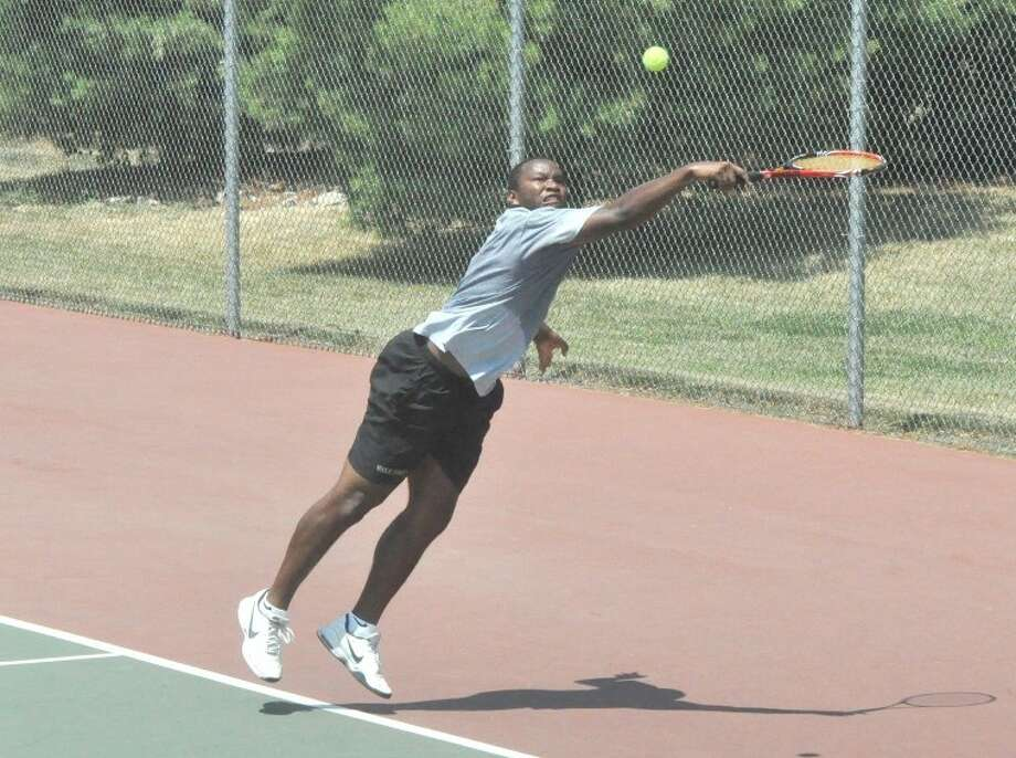David Hopkins, a tennis player from Wake Forest University, lunges to make a difficult return on Wednesday at the EHS Tennis Center in the doubles finals of the wildcard tournament for the main draw of the Edwardsville Futures Tournament.