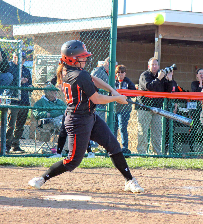 Edwardsville senior Hayli Green swings a pitch in the seventh inning in Monday's home opener against Gillespie. Green had a two-run homer for the Tigers.