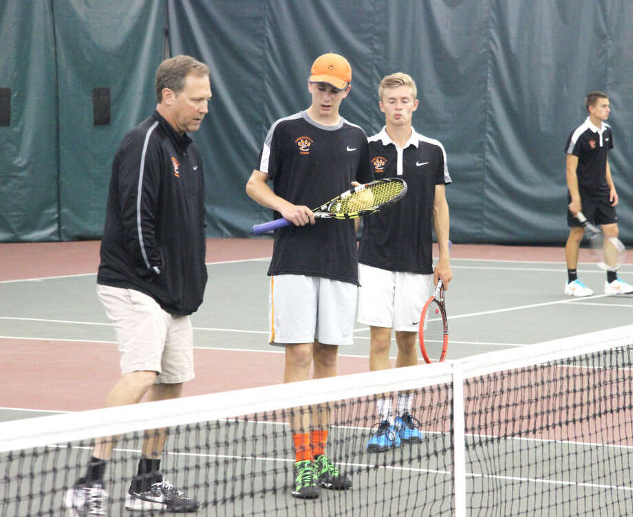 Edwardsville coach David Lipe gives Alex Gray and John Koons advice in between games of their final match against Belleville East.