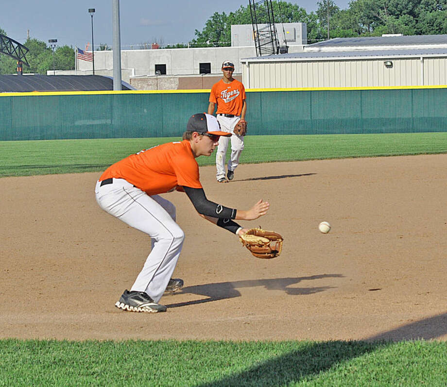 Edwardsville third baseman Tyler Starner fields a ball off the bat of a Mascoutah hitter during the fourth inning.