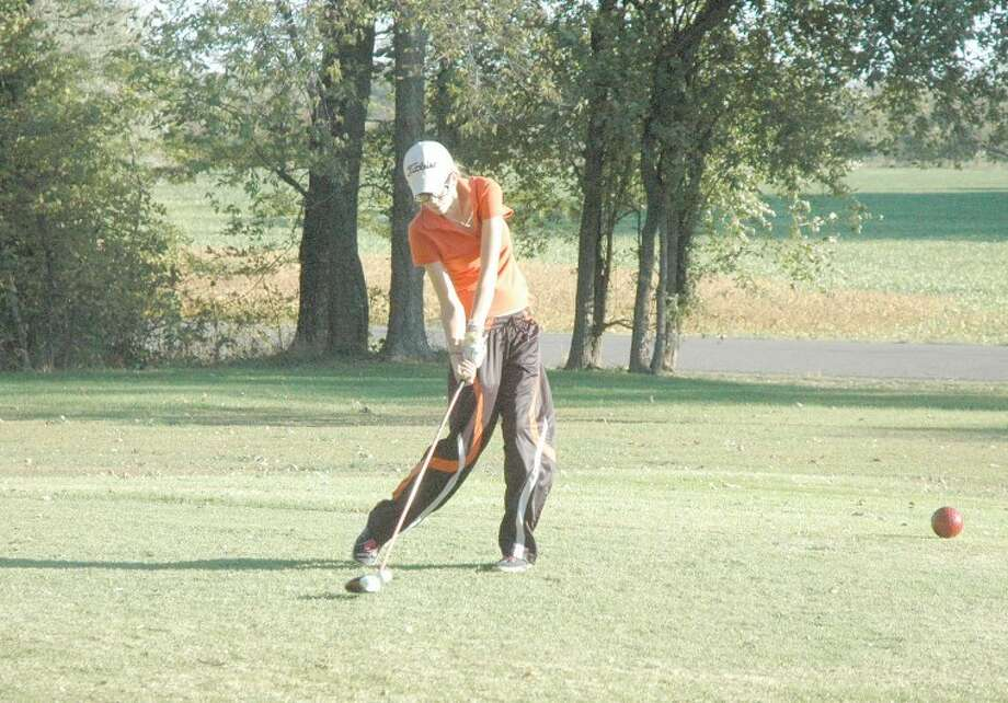 Left, Edwardsville's Emily Briley drives the ball on hole No. 1 at Oak Brook Golf Club on Friday.