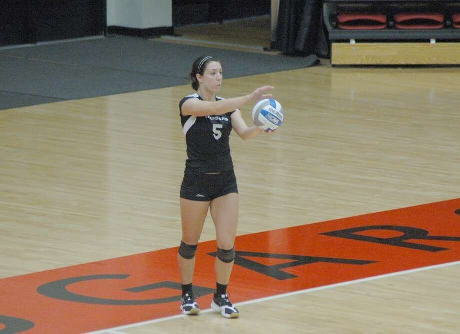 Former MELHS standout and current Cougar Brooke Smith prepares to serve against Eastern Kentucky on Saturday at the Vadalabene Center. Smith is in her junior season at SIUE.