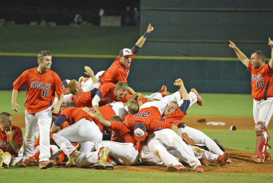 Tyler Mikrut (top of pile) and his teammates celebrate after the title game. Photo: USI Photography