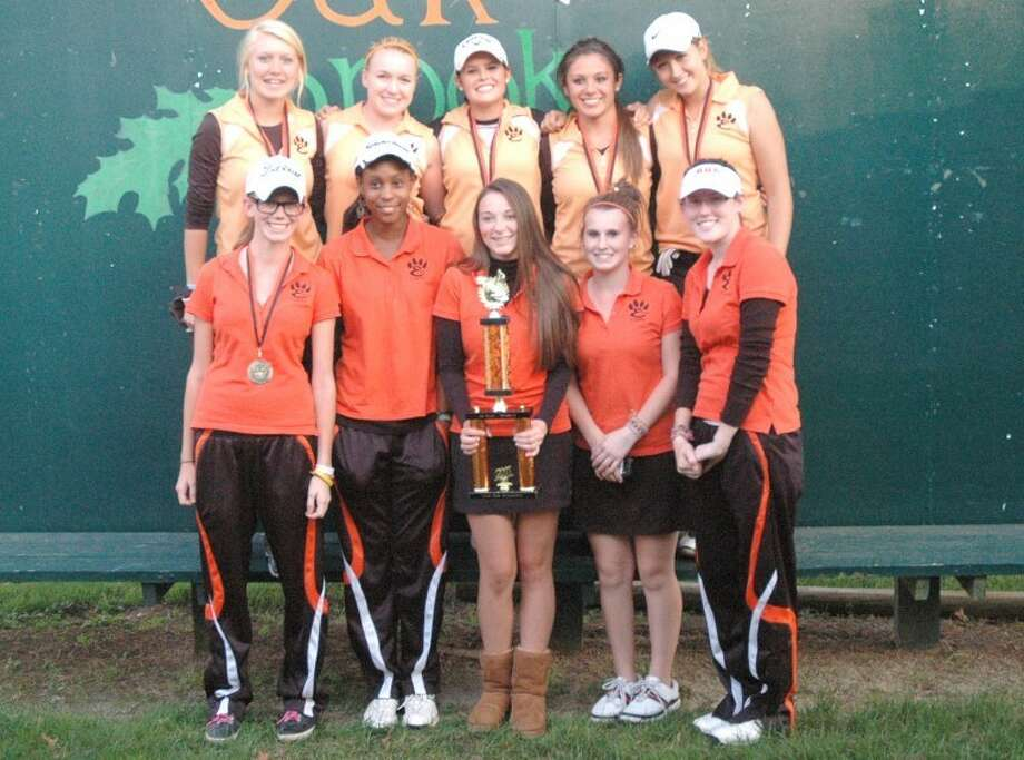 The Edwardsville Tiger girls' golf team poses with its first place trophy from the Gary Bair Invite at Oak Brook Golf Club on Friday. Now EHS turns its attention to the Class AA Springfield Regional at Lincoln Greens Golf Course on Wednesday.