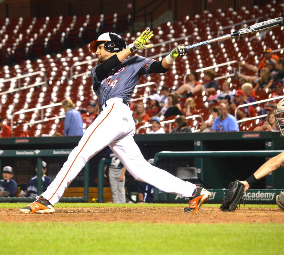 Edwardsville senior Fahd Shakeel follows through on his swing after getting an RBI single in the bottom of the fifth inning in Saturday's game against Farina South Central at Busch Stadium.