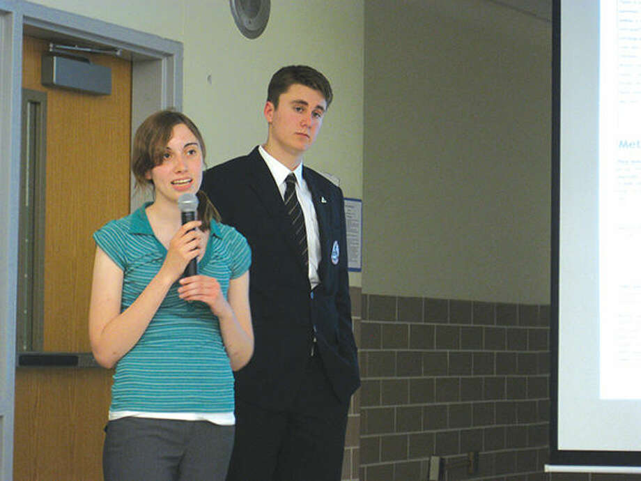 Edwardsville High School students Rebecca Laurent and Jacob Vandever speak at a recent Edwardsville District 7 Board of Education meeting. Photo: Julia Biggs/Intelligencer