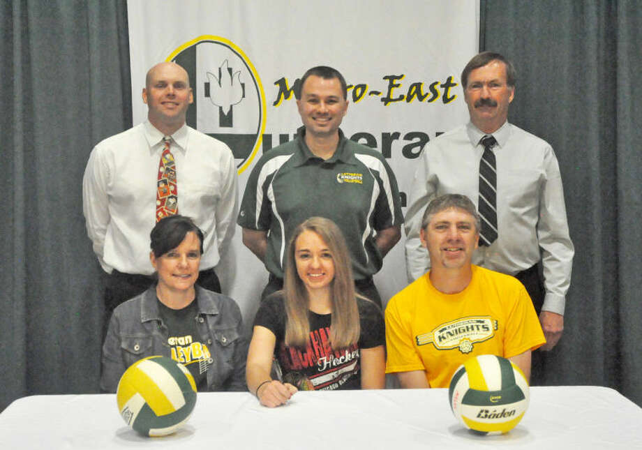 Metro-East's Mckenna Judge will play volleyball at Avila University. Seated from left are: Lisa Judge, mother, Mckenna Judge and Mark Judge, father. Standing from left: MELHS assistant principal Rob Stock, MELHS head coach Jon Giordano and MELHS athletic director Dave Redden.