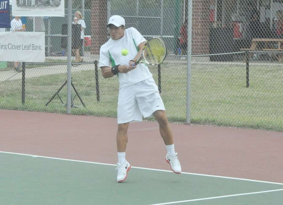 Danny Nguyen hits a backhand shot during the doubles championship match of the Edwardsville Futures on Sunday.