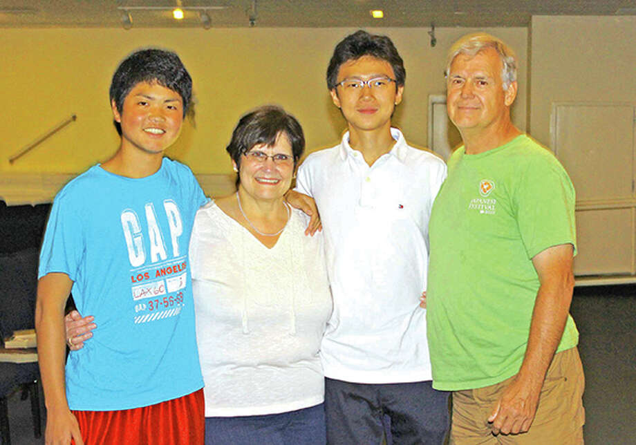 Host parents Cindy (second from left) and Jerry Berquette (right) pose with Yasuake Nose from Japan (left) and Tony Yuan from China. The boys, both 15, spent the 2013-14 school year with the Berquettes as exchange students while attending Gateway Legacy Christian Academy in Glen Carbon. Photo by Scott Marion.