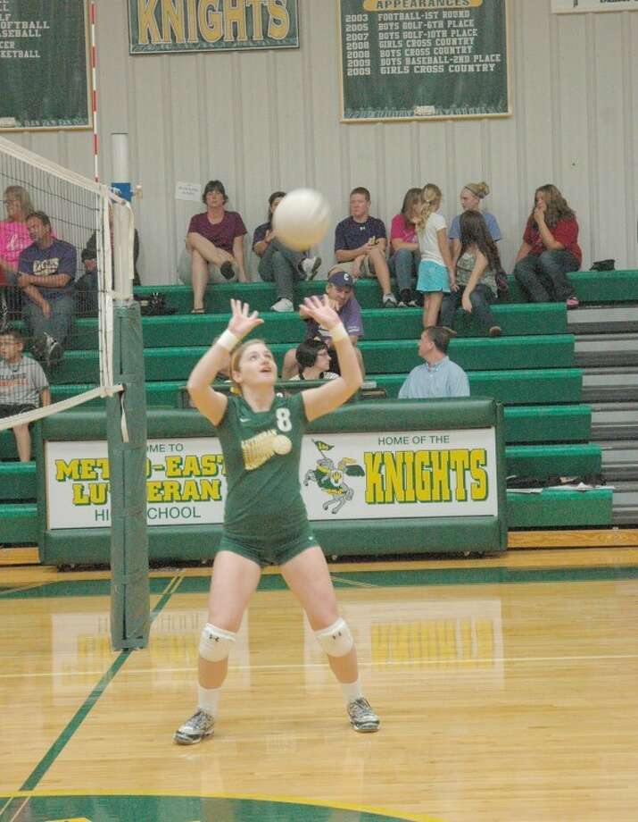 Knight setter Mackenzie Gottlob attempts to set a pass during play against Civic Memorial on Thursday at Thomas Hooks Gym. The Eagles defeated MELHS in three sets.