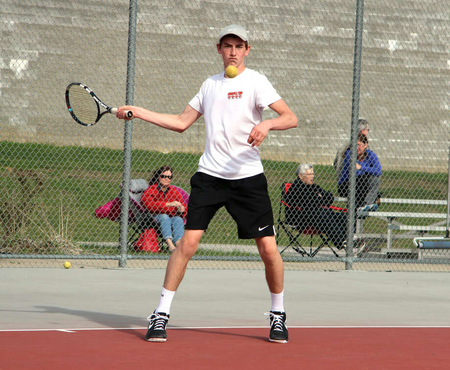 Edwardsville sophomore Dan Thomas keeps his eyes on the ball Tuesday during his No. 5 singles match with Alton's Carson Freeman.