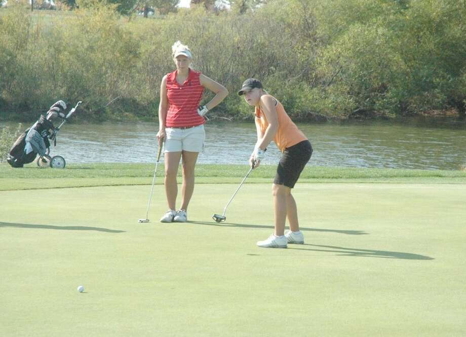 Tiger Austin Gordon watches her putt roll towards the hole during the Mattoon Sectional.