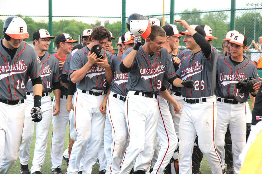 Edwardsville junior Jake Garella (No. 9) is greeted by his teammates after hitting a home run in a 4-1 win over Lockport on May 8 at EHS.