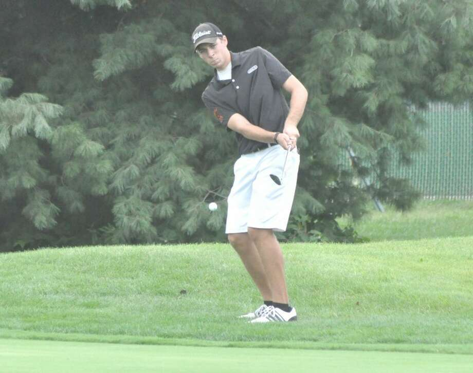 Edwardsville Tiger Drew Curtis chips in for eagle on No. 9 at Spencer T. Olin Golf Course Tuesday during the Redbird Invitational in Alton. Curtis and John Schmidtke tied to lead the Tigers with 78 scores.