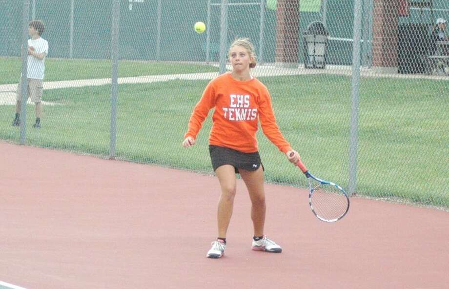 Edwardsville Tiger Megan LaRose hits a return in a recent dual match with St. Joseph's Academy at the EHS Tennis Center. On Saturday LaRose earned a Southwestern Conference title at No. 6 singles during the SWC Tournament.