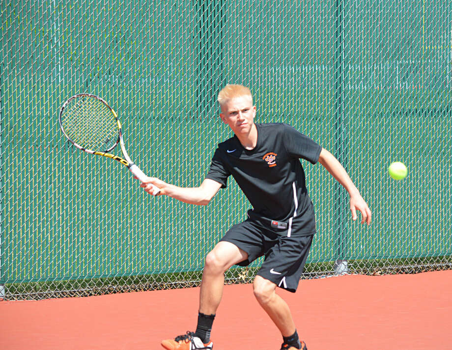 Edwardsville senior Luke Motley returns a shot against his Carbondale opponent in the first set of their match.