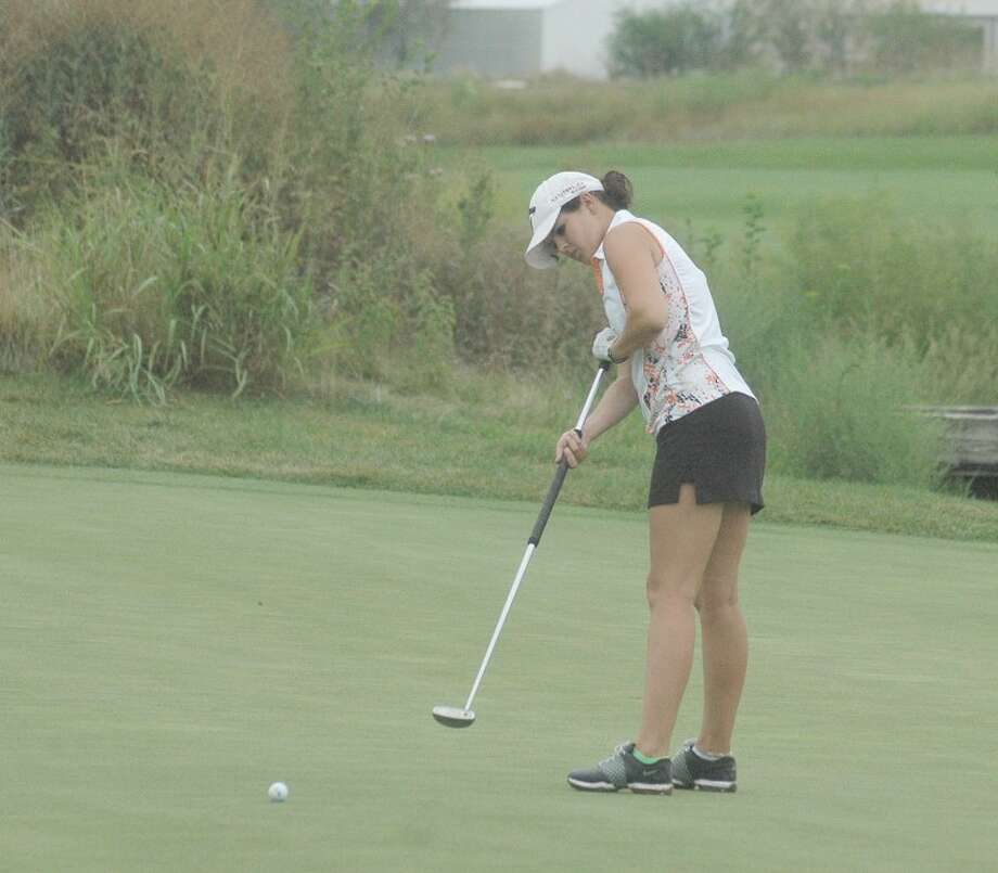 Edwardsville senior Brie Duvall watches her putt on hole No. 10 at Gateway National Golf Links on Tuesday.