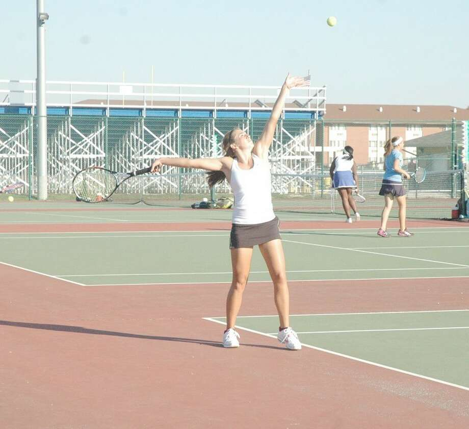 Tiger Jessica Burns prepares to serve in the No. 1 doubles title tilt against Belleville West on Friday in O'Fallon.