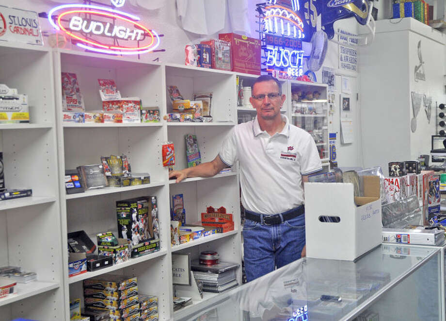 Ben Farnsworth stands behind one of his card displays at Goodsports Sports Cards and Memorabilia. Farnsworth is in his 15th year in business at the 1990 Troy Road store.