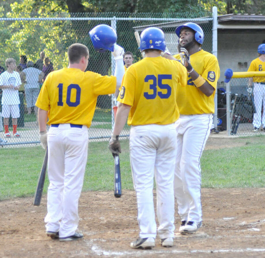 Edwardsville Post 199's Jevon Boyd is congratulated by teammates Chase McPeak (10) and Devin Breihan (35) after a first inning two-run home run Tuesday vs. Glen Carbon Post 435 at Hoppe Park.