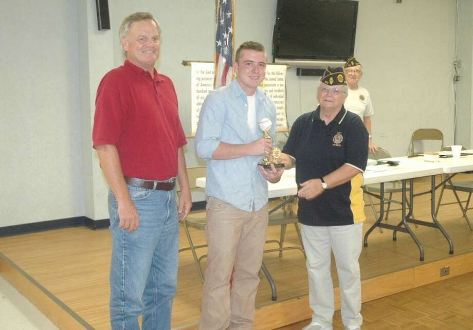Pictured left to right are: Post 199 manager Ken Schaake, McPeak and Post 199 Vice Commander Ricki Shutta.