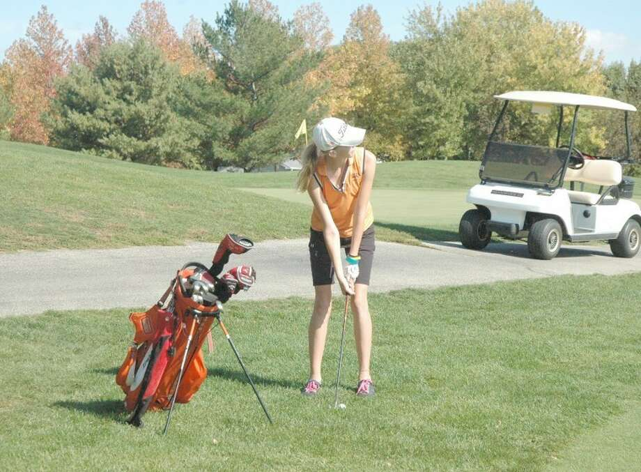 Edwardsville's Emily Briley prepares to chip on to the green at Meadowview Golf Course in Mattoon during the Class 2A Mattoon Sectional.
