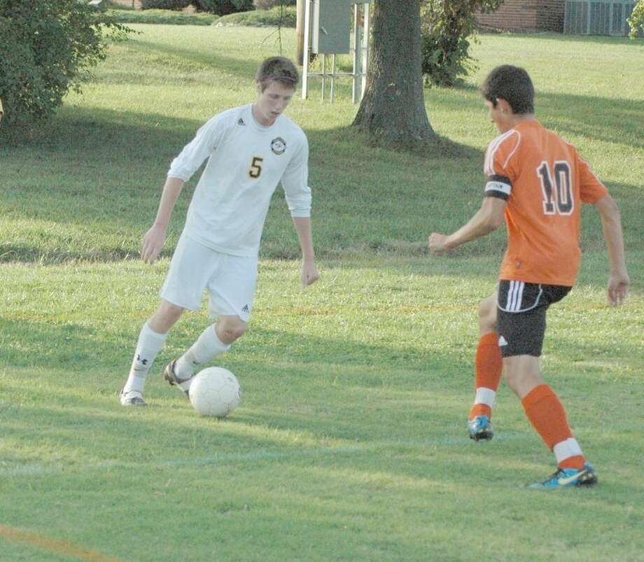 Metro-East's Evan Winenger looks to dribble past a Wesclin defender on Sept. 20. Winenger and the Knights will begin their postseason trek at 7 p.m. tonight vs. Greenville.