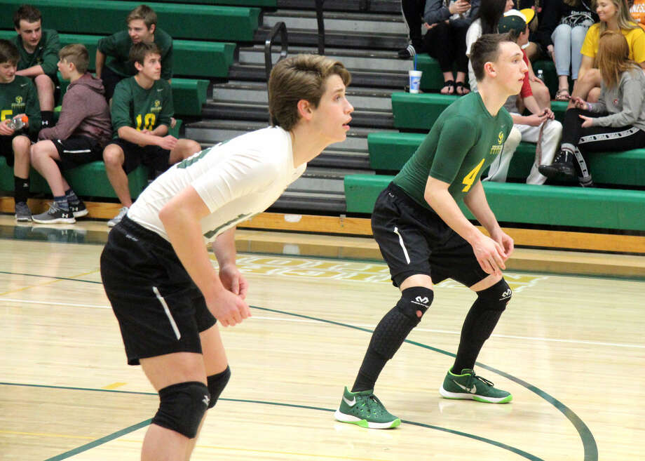 Metro-East Lutheran senior Joseph Babcock (left) and junior Thomas Schroader await a serve from Alton during Tuesday's home match.