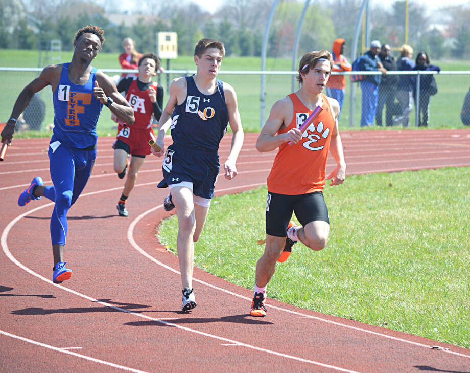 Edwardsville's Franky Romano breaks away from O'Fallon and East St. Louis runners in the 3200-meter relay.