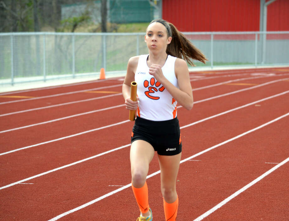 Edwardsville freshman Payton Flowers competes in the third leg of the 3,200-meter relay during Wednesday's quadrangular meet at Alton High School.