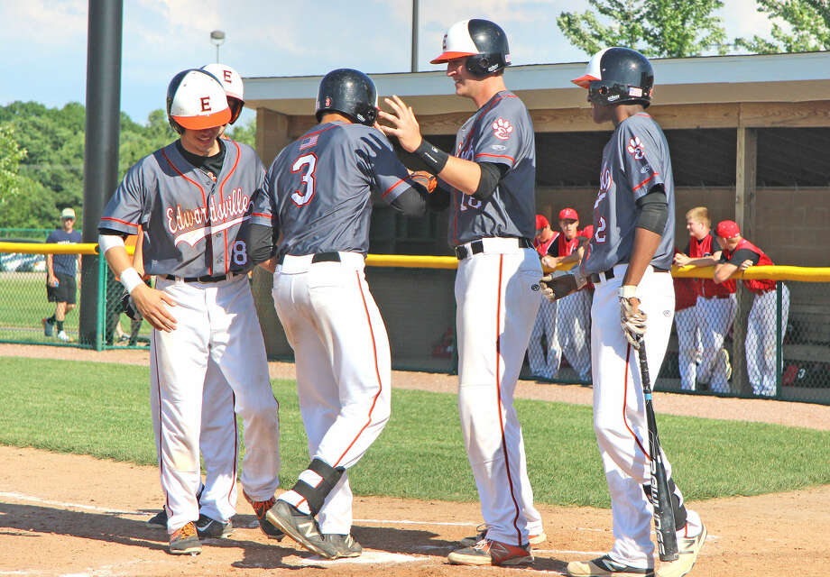 Edwardsville's Jordan Hovey (3) is congratulated by his teammates after hitting a home run in a 17-0 win over Pekin in a Class 4A regional semifinal May 27 at Tom Pile Field.
