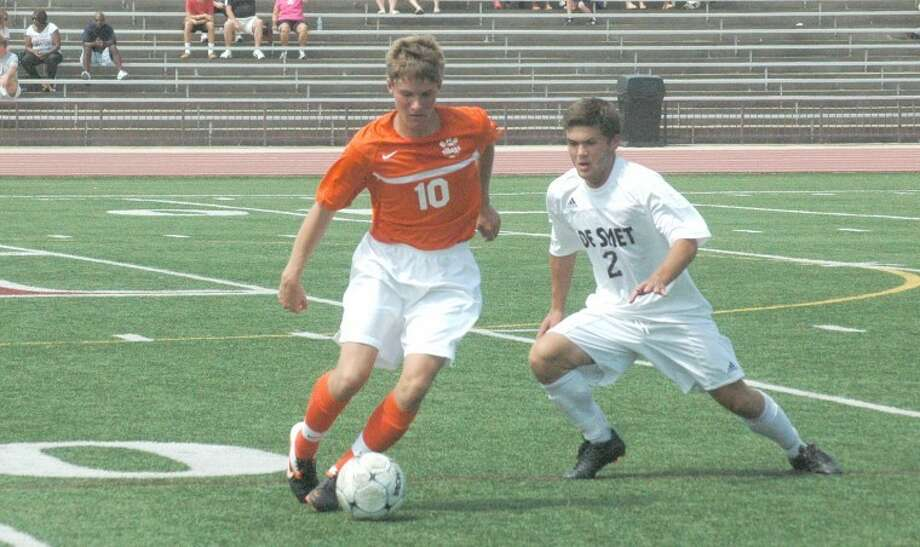 Edwardsville Tiger Landon Paul dribbles around a De Smet defender at De Smet during the 2012 season. Paul and the rest of the Tigers are primed for another big season in 2013 as they try to train during the summer months.