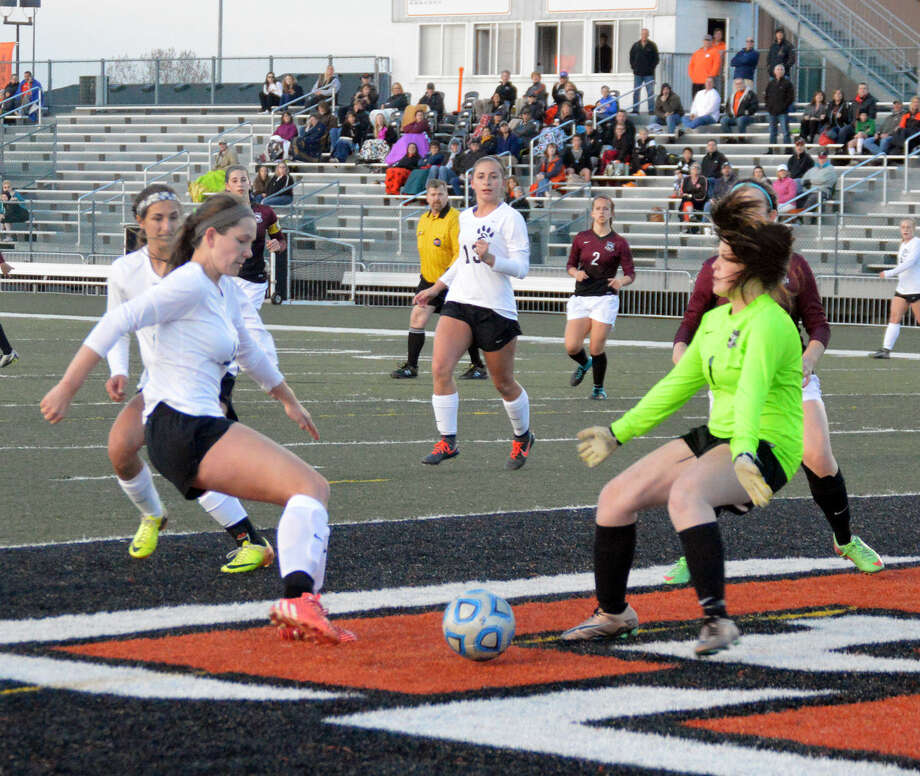 Edwardsville's Allysiah Belt, left, beats the Belleville West goalkeeper with a shot in the 16th minute to give the Tigers a 1-0 lead on Tuesday.
