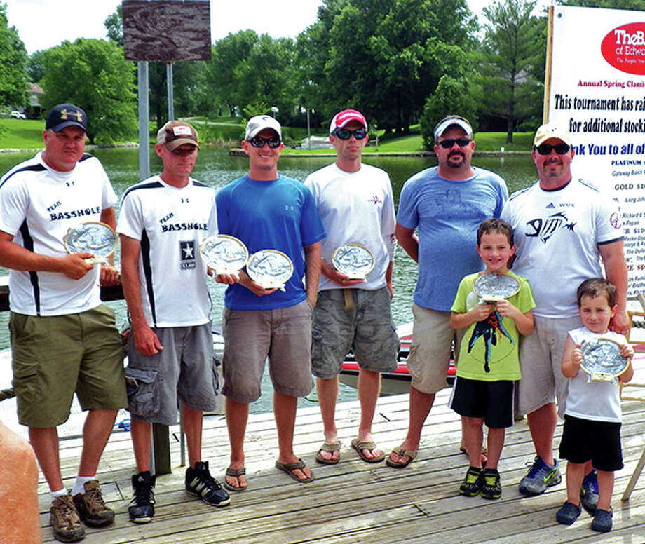 Trophy winners of this year's BANK of Edwardsville Annual Classic held on Holiday Lake are Kevin Sanderson and Jay Schmidt (second place), Phillip Tate and Adam Ohms (third place) and Brennan Murphy and Jeff Wahl (first place) with Jacob and Myles Wahl holding the hardware. The fishing tournament has generated a total of $17,200 that has assisted in restocking Holiday Lake. Cash prizes were awarded to the top 10 two-man teams that brought in the heaviest catch for both days. Photo by Laura Scaturro.