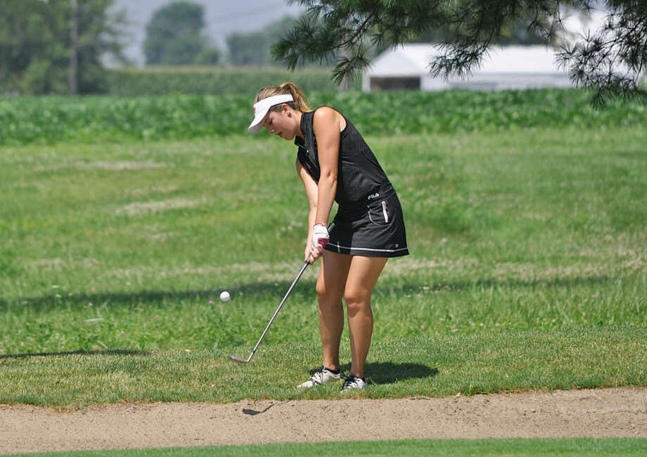 Megan Quick hits a chip shot on to the No. 3 green at Oak Brook Golf Club in Edwardsville on Friday.