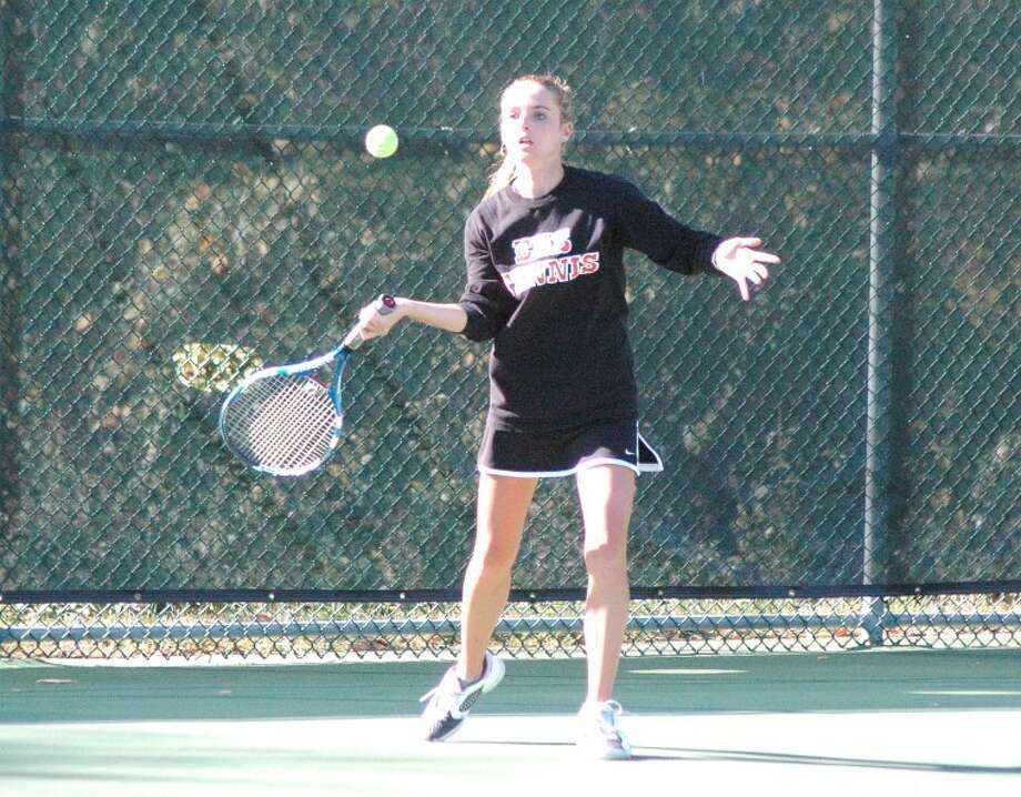 Edwardsville Tiger Morgan McGinnis hits a forehand shot Saturday at Lewis and Clark Community College during the Alton Sectional. McGinnis won the singles' sectional title, helping the Tigers to their 15th consecutive team sectional championship.