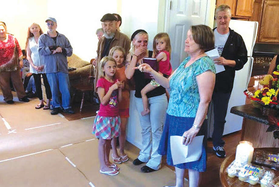 On Friday, before the Memorial Day weekend, a tearful Cassie Cusimano and her daughters, Emmah, Hannah and Myah receive the keys to their new home from Habitat for Humanity representative Taletta Watson. This is the sixth home the Edwardsville-Glen Carbon Chapter has built in the community and the first built in Worden. Cusimano said she is looking forward to decorating her new home and planting flowers with her children. Photo: Laura Scaturro/Intelligencer