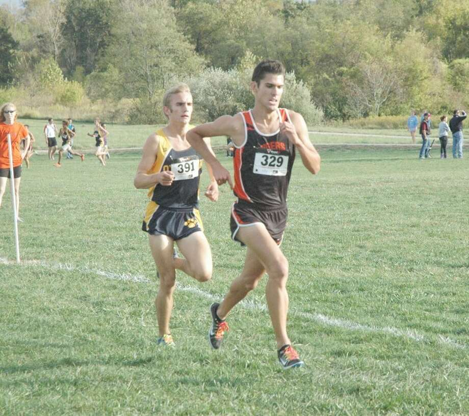 Tiger Garrett Sweatt, right, leads Panther Alex Riba, left, after the first mile of the Southwestern Conference Tournament