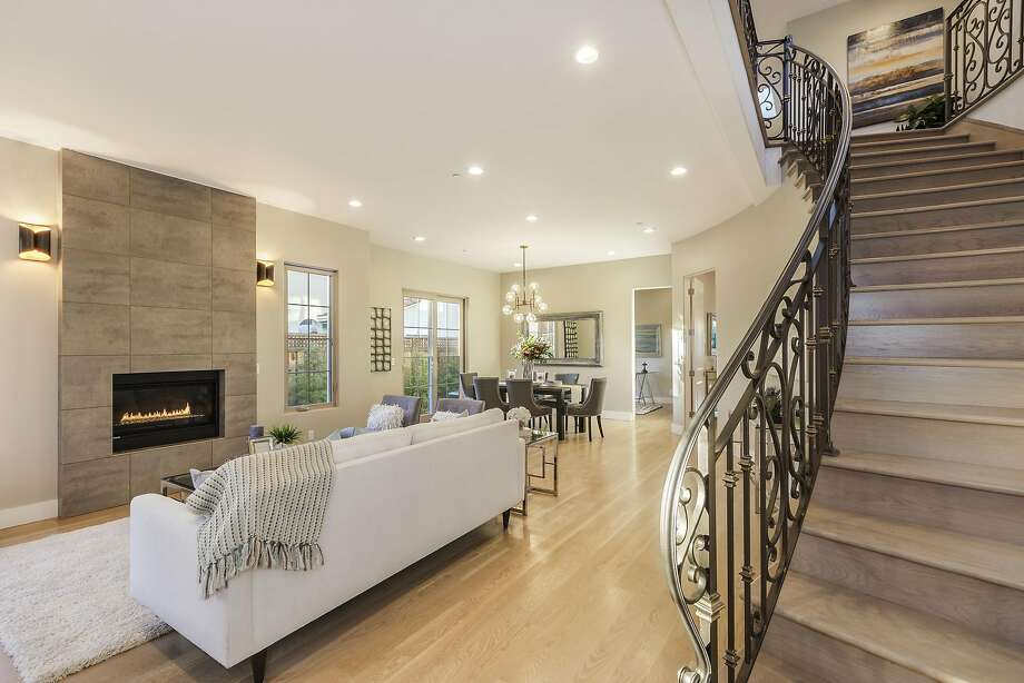 A dramatic curved staircase ascends to the upper level of the Cupertino home at 21825 Lomita Ave. Photo: Rob Jordan Photogaphy�