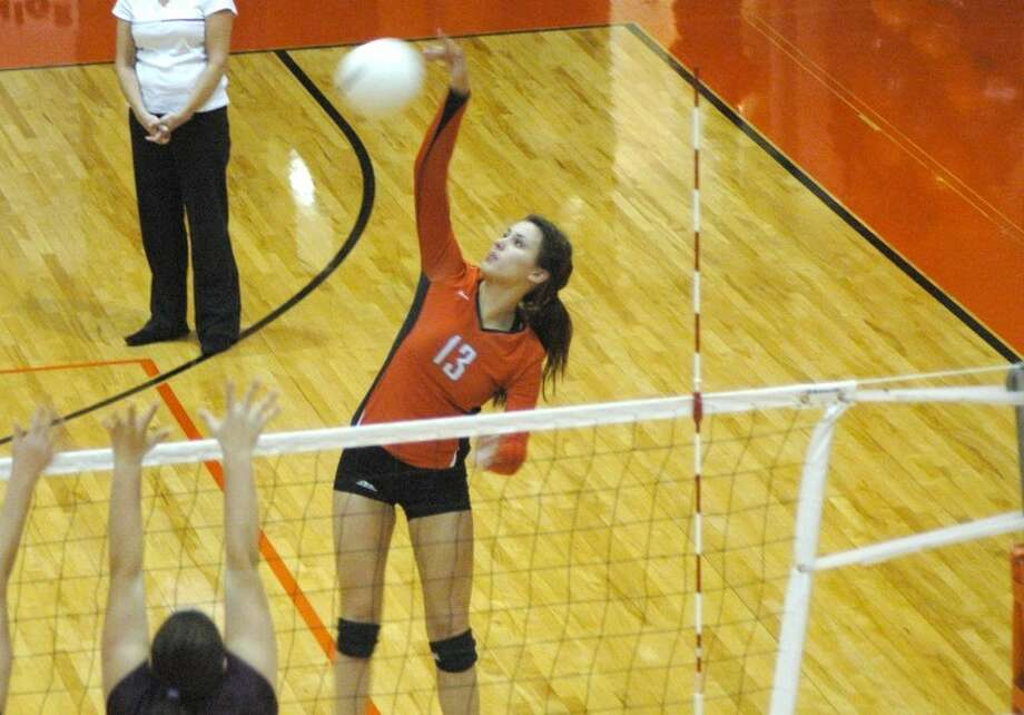 Edwardsville sophomore Camrey Saye goes up for a kill Tuesday at Lucco-Jackson Gymnasium against Belleville West. The Tigers defeated West 2-0 on their Senior Night to secure the Southwestern Conference crown.