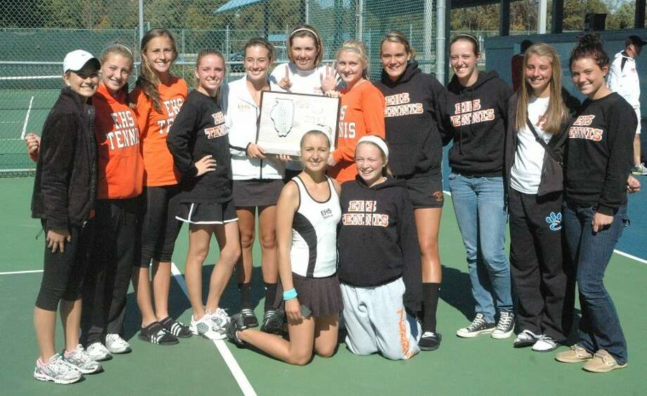 The Edwardsville Tiger girls' tennis team poses with their Alton Sectional title plaque which they won Saturday. It was EHS' 15th straight sectional title. The Tigers began play at the state tournament today.